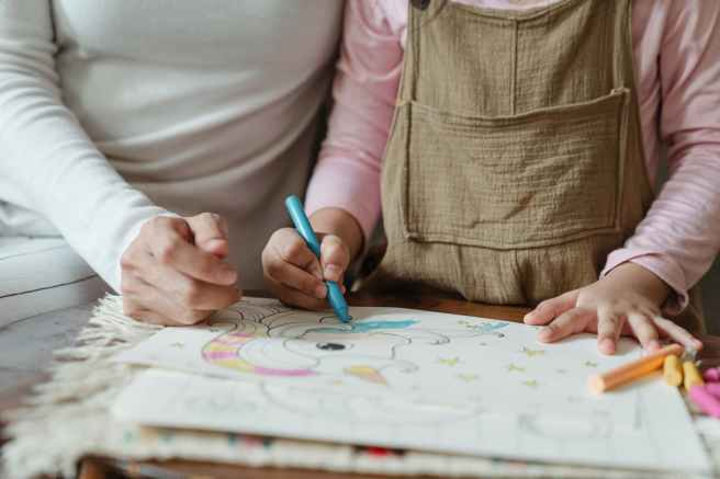 crop mother and kid coloring pictures on paper