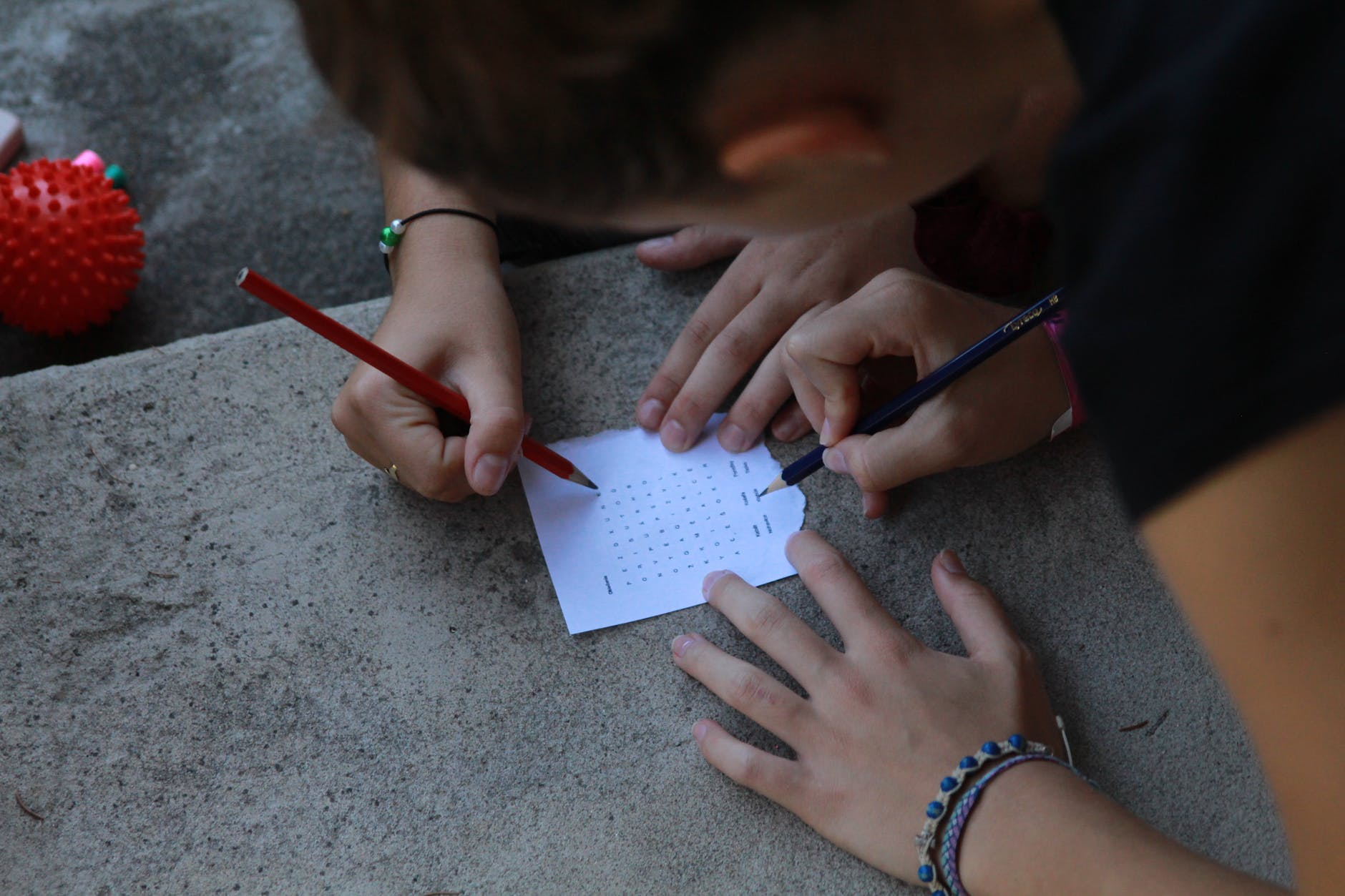 people solving a word puzzle