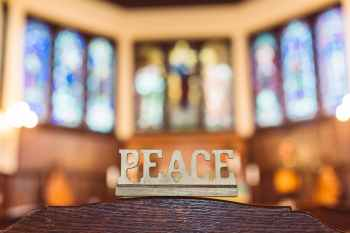 peace word carved in wood